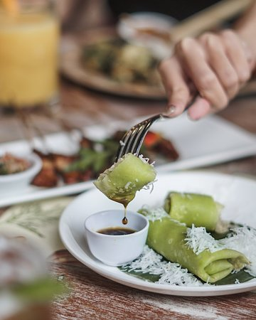 Base Base Samasta: Green, soft, sweet and yummy, this Pandan Balinese Pancake (and brown sugar dip) will gladly accompany your afternoon break. Order one now at Base Base Samasta! ✨🌴💚 . #basebase #jimbaranfood #samastabali #balinesefood #makananbali ----- balinese restaurant jimbaran