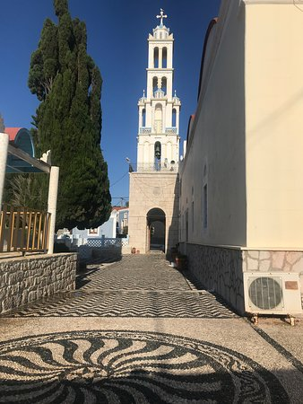 church tower @ chalki island with beautiful peeble mosaics courtyard