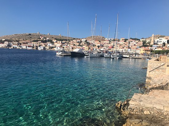 clear waters of chalki seaside and yacht pontoon