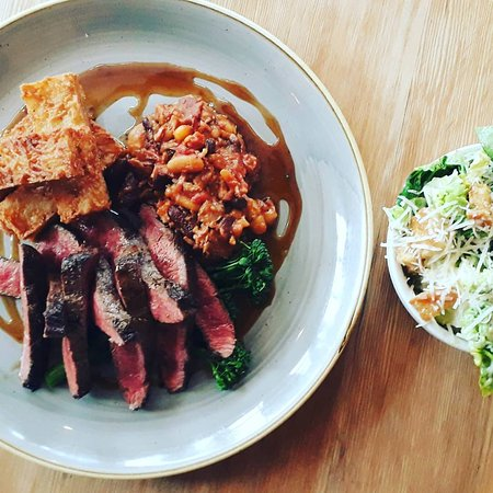 Pan fried 6oz bavette steak, bourguignon bean cassoulet, horseradish confit chips and fine beans with a caesar salad side