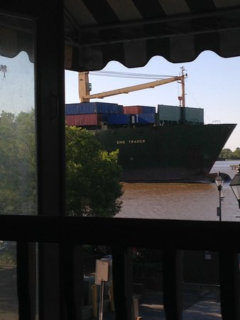 The Cotton Exchange Tavern & Restaurant: View from table of passing cargo ship.