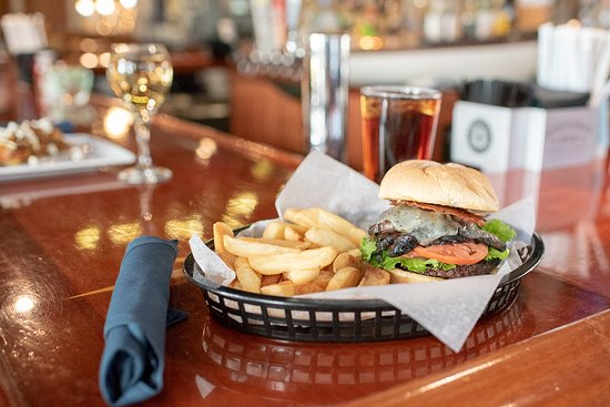 Oliver's and Planck's Tavern: Our Portabella Burger with steak fries and added cheese (12.99)