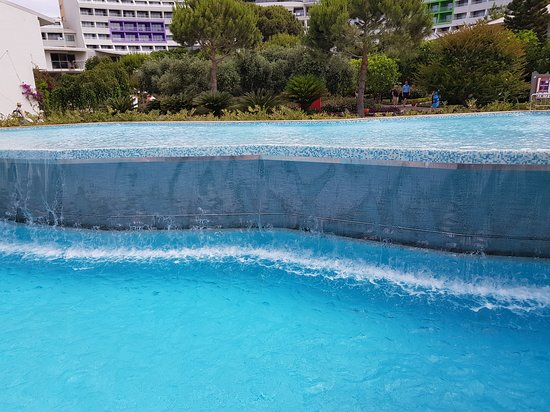 Cornelia Diamond Golf Resort & Spa: Waterfall in the pools during the day