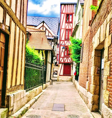 Places to Go and See in Rouen France - All the old town streets in and around the cathedrals are very picturesque seeing the colourful timber framed houses with nearly always the sight of one of the many cathedral steeples in the background.