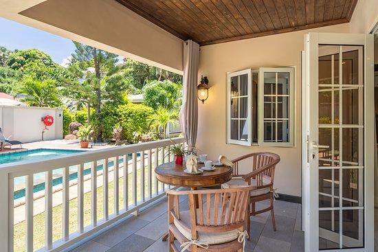 Cottage 3: Open veranda overseeing the common swimming pool