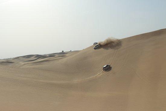 Abu Dhabi: 7-Hours Desert Safari with BBQ, Camel Ride & Sandboarding: Dune bashing
