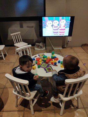 Kids playroom, there\'s a tv, some blocks, coloring pencils ...