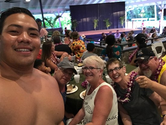 "Toa Luau at Waimea Valley: We asked for a picture of our group at the table but also got a selfie with our new ""cousin"""