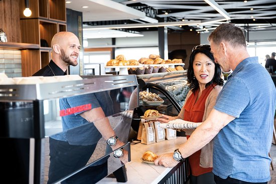 Open at 7:30 am the cafe offers fresh baked goodness and full barista service. Cafe Manager Patrick makes sure a smile is always part of your morning.