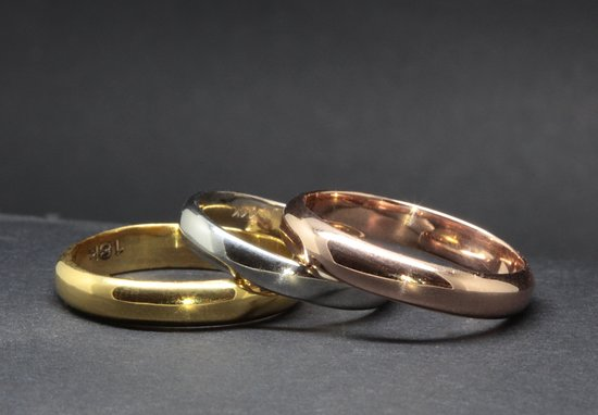 We can make a simple man's gold wedding band in less than a week, and we also have some in permanent stock. We work in yellow, white and rose gold in 18k and 14k.
