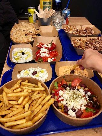 Gyros, tzatziki, greek salad, tyrokafteri, pita, stuffed peppers with feta
