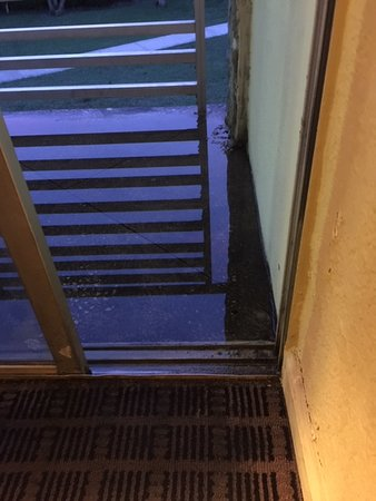 Water that was on flooded balcony seeped into room and rug was soaked. Balcony Slider doors wouldn't lock.