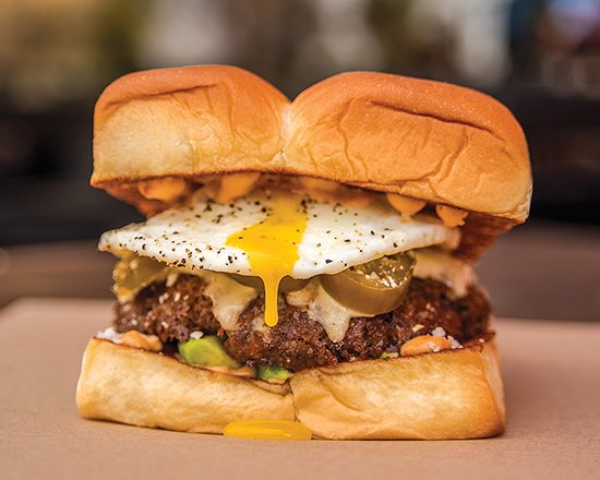 Dog Haus NoHo: LITTLE MULE – white american cheese, avocado, pickled jalapeños, cotija cheese, fried egg, chipotle aioli