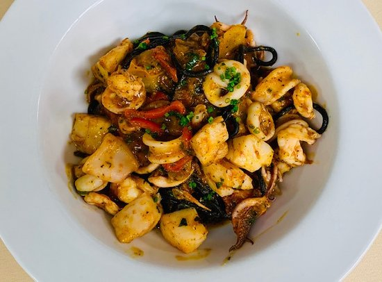 Assaggi: CHITARRA AL NERO Squid ink pasta, shrimp, scallops, calamari, red pepper bell, capers, tomato sauce