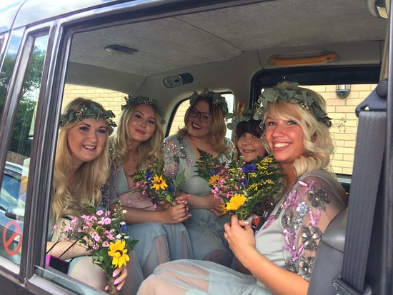 My Taxi Home: The Bridesmaids smiling for one last photo before starting their journey to the wedding venue at St. Neots' Priority Centre.