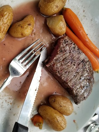 North Bennington, VT: Flank Steak Roasted fingerling potatoes, house vegetables, and burgundy cream sauce  27.95