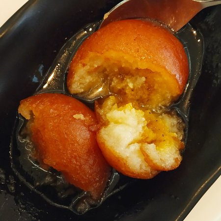 Gulab jamuns (translated very roughly as 'rose-fruits') got their name from the fact that they resemble a jamun (a subcontinent fruit)