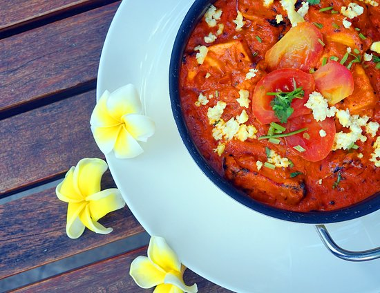 Bollywood Indian Cuisine: Paneer Tikka Masala marinated of clay oven cottage cheese with Indian Spices, green capsicum and onion tomato gravy