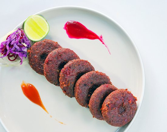 Bollywood Indian Cuisine: Beetroot Kebab fried mashed beetroot crumble served with chutney.