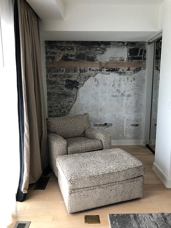 closet and seating nook in bedroom.