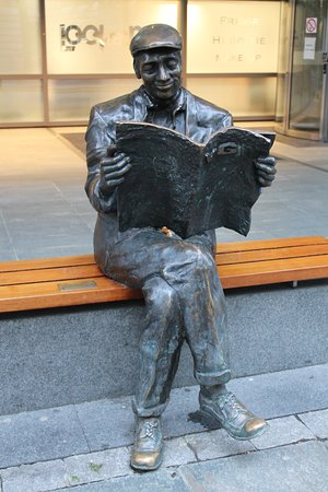 Sculpture of man reading VG