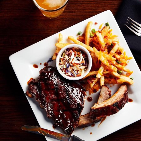 Low-n-slow cooking makes our ribs fall-off-the-bone! Served with our homemade coleslaw, full of tang.