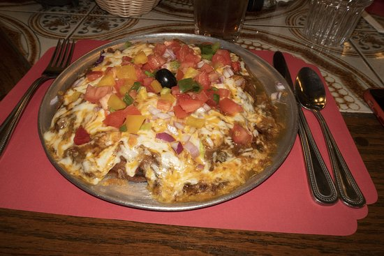 Navajo green chili pizza - sopapilla crust, beans, green chile, cheese and veggies and shrimp