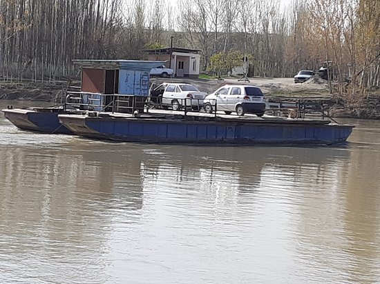 Sirdaryo Province, Uzbekistan: Vehicle crossing river on Cargo