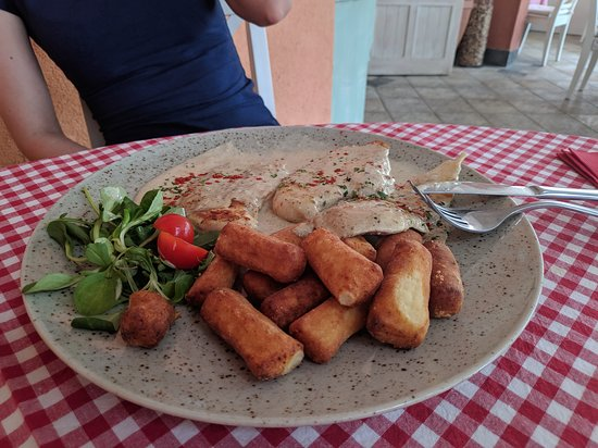 chicken fillet with potato nuggets in mushroom and gambere sauce
