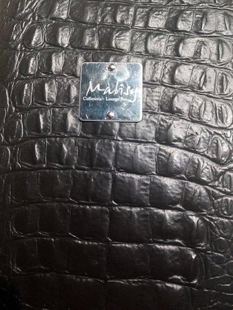 Malisy: il logo del locale nella brochure del menù