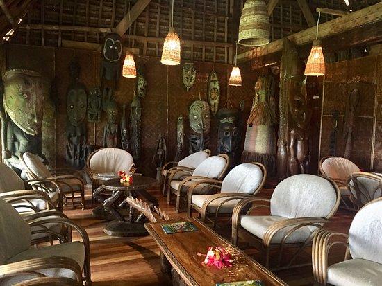 Kundiman, Papua New Guinea: Main lodge building at Karawari, showing extensive collection of masks and spirit figures.
