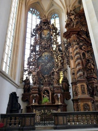 Impressive church with a massive wooden altar and a surprise and its tall tower