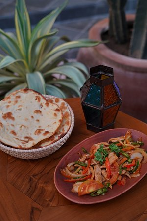 Abunawas Restaurant Bali: Craving for some hot dishes? Go with Mugalgal. A combination of meat (lamb or chicken), fresh tomatoes, onions & green pepper, fried together with medium hot spices. Served with slices of Tannour (bread).