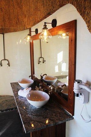 Each room has its own on-suite bathroom overlooking the desert.
