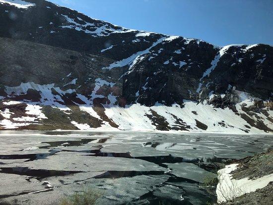Geiranger Skywalk - Dalsnibba, Europe's highest fjordview 1500 m: Partially frozen lake