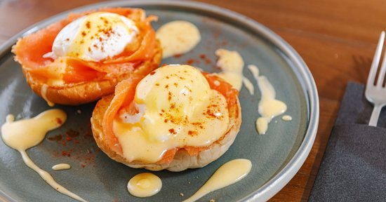 Royale (Salmon) - 2 poached eggs, salmon, freshly baked brioche served with a homemade hollandaise sauce