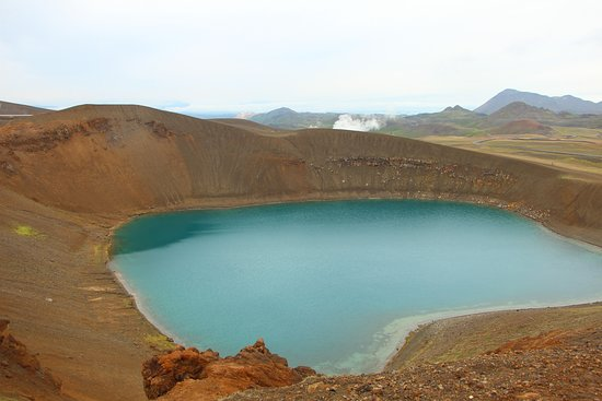 Above Viti crater, with steaming geothermal plant in the distance