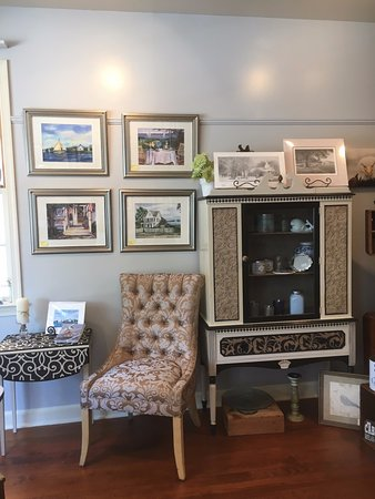 Artwork by local artist Linda Luke, and decorated furniture with paper & fabric by Terri Griffin