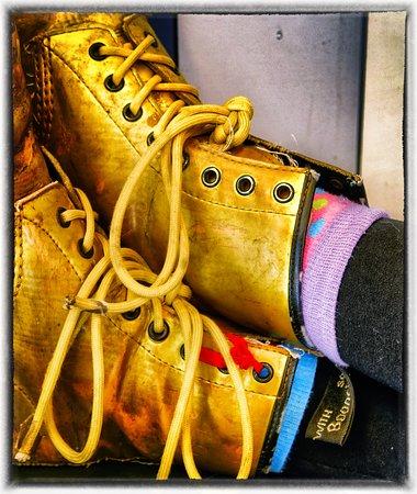Closeup of rather natty boot/sock combo worn by Courtyard waitress.