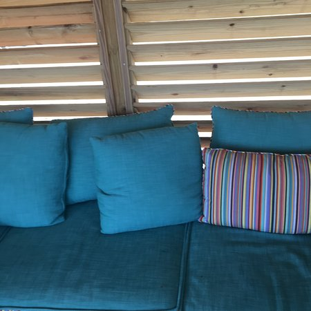 CocoCay Chill Island Cabana three person couch, wood slated walls