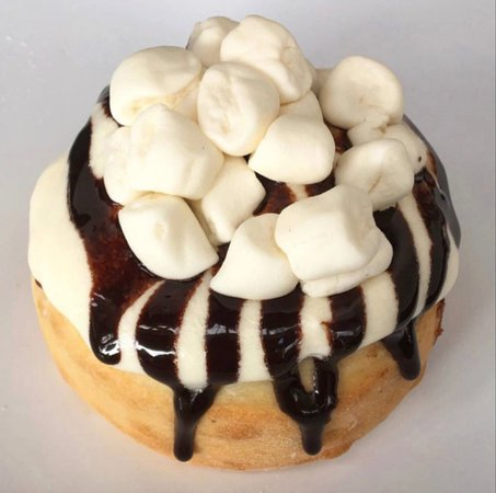 Orange Creamsicle Roll made with Orange Cream Frosting, Marshmallows, and Chocolate Sauce!
