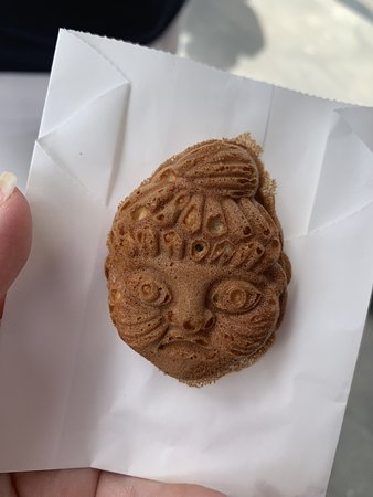 Tokyo - Japans Cultural Curiosities Private Tour Including Food Samplings: Cookie in shape of a god. Delicious traditional Japanese snack!