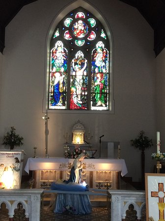 Altar and stained glass window over