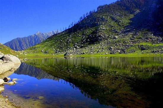 Kareri, India: Clear weather; A place with Picturesque view. peaceful valley of snow with white water lake;