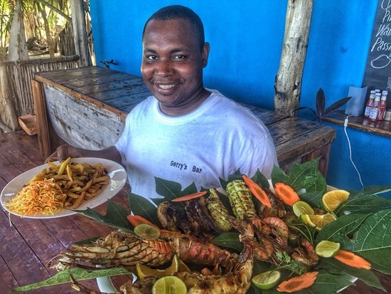 Kilindoni, Tanzania: My friend cooking cocking good for my tourists visiting Mafia island.the season of Whale shark will be starting soon