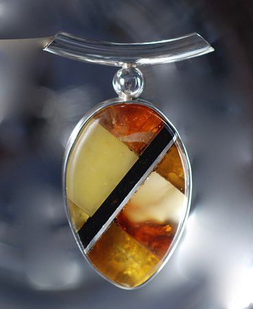 Ravhuset Hennebjerg: This pendant is a mosaic of Jet, amber and Silver - thousends of options and designs. Create your own design !!