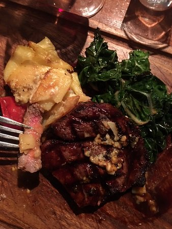 The Gintrap Restaurant & Bar: Just looking at this photo makes my taste buds water because I know how mouth wateringly perfect this was from the pototo stack dressed with blue cheese to that steak