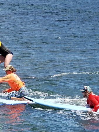 Group Surf Lesson in Lahaina: Instructors helping young kids