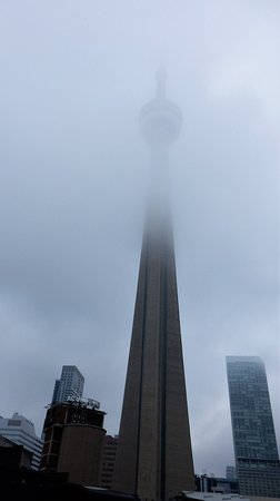 The CN Tower on a misty day - photographed near the Toronto Railway museum.