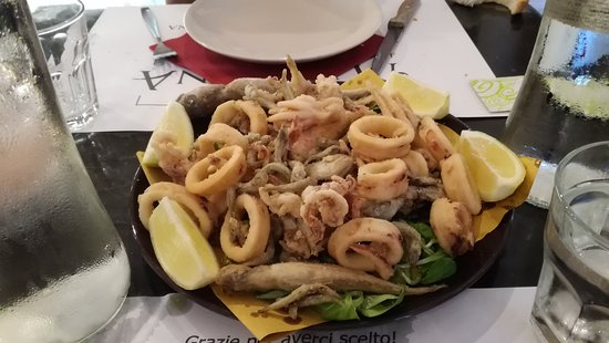 Malaspina Bistrot: Frittura di paranza Paranza fry (The frying of paranza is a fry of fish of small cut diffused in many zones of Italy. It takes the name from the paranza, that is a typical fishing boat for the trawl fishing commonly employed by the Italian marines)